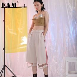 6259d2fdef01 X  EAM  2018 Autumn New Fashon Cut Hollow Out Bottom Side Striped Loose  Trendy Wide Leg Pants Women Calf-Length Pants YC35100