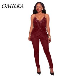 7ab31b14f93 OMILKA 2017 Autumn Winter Women Strap V Neck Mesh Sequin Bodycon Rompers  and Jumpsuits Sexy Backless Tassel Club Party Overalls
