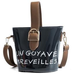 mini buckets cartoon 2019 - 2018. Women's Bags. Ladies fashion casual bag. PU. Small. Mini. Cross Body. Shoulder Bags. English letter. Handbag.