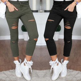 $enCountryForm.capitalKeyWord NZ - New Skinny Jeans Women Denim Pants Holes Destroyed Knee Pencil Pants Casual Trousers Black White Stretch Ripped Jeans
