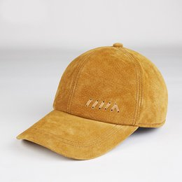 ed2e9bd60ca men autumn spring Genuine leather baseball hats teenager Ginger yellow  Korean style ball caps male bandage outdoor climb adjustable snapback