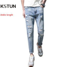 Hip Hop 2018 Ripped Jeans for Men Patchwork Hollow Out Printed Beggar  Cropped Pants Yong Man Cowboys Japan Style Trendy Hombre d341efa1f