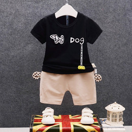 $enCountryForm.capitalKeyWord NZ - Fashion Infant Cartoon Dog Clothes Summer Baby Boys Girls T-shirt Short Pants 2Pcs Sets 2018 Children Pure Cotton Clothing Sets