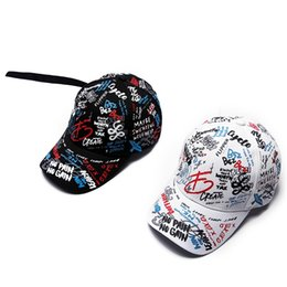 68c1bd533f3d9 Children s hat graffiti printed baseball caps parents kids cap long tail  hip-hop sun hat kids and mom dad fashion matching hats caps