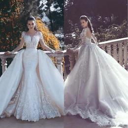 Discount dubai wedding dresses - 2018 Designer Backless Mermaid Lace Wedding Dresses With Detachable Train Long Sleeves Bead Tulle Overskirt Dubai Arabic