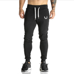 cotton yellow workout pants Canada - New Men Jogger Pants Sportswear Pants Casual Elastic Cotton Men's Fitness Workout Pants Skinny Mens Sweatpants Trousers M-XXL