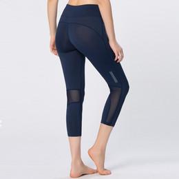 fd5d79e6db41 New Sporting Workout Leggings Women Sexy Mesh Splicing Reflective Night  Runs Fitness Legging Breathable Elastic Slim Capri Pants