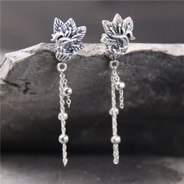 $enCountryForm.capitalKeyWord UK - S999 silver coin antique, carved peacock earrings, Thai silver tassel temperament, female studs