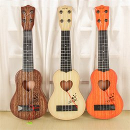 Guitar strinGs for sale online shopping - Early Childhood Education Toys Ukulele Multi Color Strings Guitar For Children Instrument Hot Sale yf C R