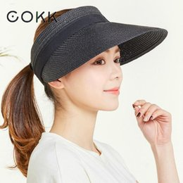 deb2fc11fbf0a COKK Summer Hats For Women Wide Brim With Bow Sun Hat For Beach Outdoor Straw  Hat Female Tennis Visor Chapeu Feminino Toca 2018 S18101708