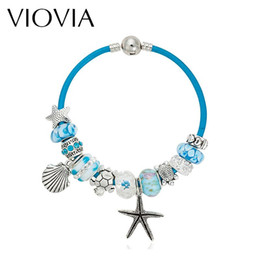 a3d61284d69 Wholesale- VIOVIA Summer Style Blue Leather Bracelets & Bangles Sea Turtle  Star Shell Charm murano glass beads bracelet for women B15180
