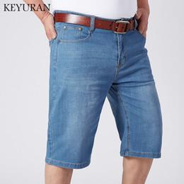 38ba5c44ec5 Large size 2018 Summer Lightweight Fashion Thin Denim Shorts Men s Loose  Jeans Shorts Men Casual Cotton Men Straight Half pants
