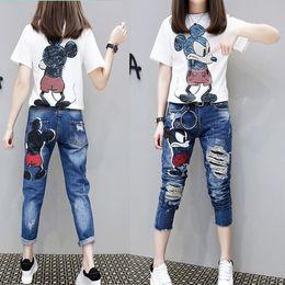 $enCountryForm.capitalKeyWord NZ - Fashion Cartoon Woman Skinny Mid Waist Jeans Female hot sell Denim Pencil Pant Elastic Ripped Girl jeans Trousers