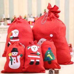 Free christmas giFts For kids online shopping - 4 Size Christmas Gift Bags Santa Sack Drawstring Bag Candy Bag For Kids Random Pattern Christmas Decoration Supplies Free Ship