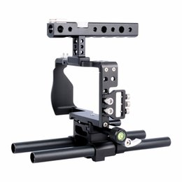 Discount dslr camera cage rig - wholesale C6 Dslr Camera Cage Rig Kit Video Film Making System with Top Handle and 15mm Rod For Sony a6500 a6300 a6000