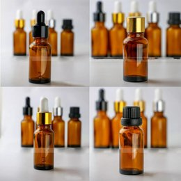 $enCountryForm.capitalKeyWord NZ - Cheap Price 20ml E liquid glass dropper bottle Amber cosmetic glass bottles with 6 Style Caps For Choice 624pcs lot DHL Free