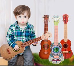 Discount child guitars - A beginner play guitar Four String child favor Guitar Toy six children 21 inch beauty instrument guita toy for kids
