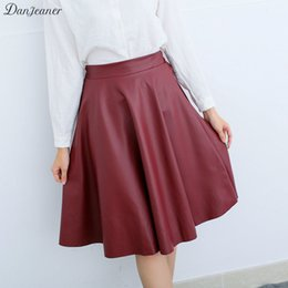 b05fa3a54e2 Danjeaner Women Autumn Winter Vintage High Waist PU Leather Skirts Female  Casual Knee-Length Elastic Waist Midi Skirts C18110801