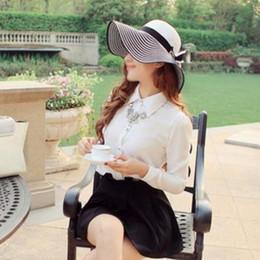 2018 negro raya blanca Bowknot chica de verano de ala ancha sombrero  sombrero de ala grande de paja trenza Sunhat Cap Beanie para mujeres b0fa441558bf