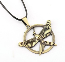 Mockingjay Chain Australia - The Hunger Games Pendant Necklace Inspired Mockingjay Vintage gold Bronze bird badge for women men Jewelry Drop Shipping