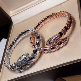 2b6961ec1094 Nuevo 3A piedra de circón cúbico medio pavimentada bijoux femme animal  serpiente pulseras brazaletes blanco   rosa   oro-color de joyería para las  mujeres