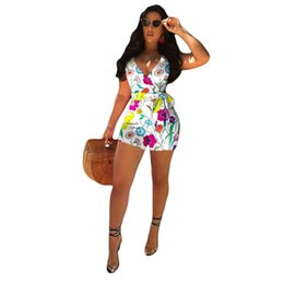 bf99487a483 Floral Printed Sexy Rompers Womens Jumpsuit Deep V Neck Short Sleeve Beach Playsuit  Summer Backless Sash Short Bodysuit