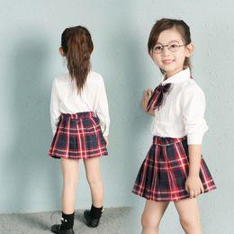 $enCountryForm.capitalKeyWord NZ - Autumn&Spring New School Style Fashion Baby Girls Dress Set White Shirt Top With Plaid Knot Tie+Plaid Mini Skirt 3 Pcs Sets 3-7T