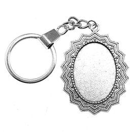 lock for mans balls NZ - 6 Pieces Key Chain Women Key Rings Fashion Keychains For Men Edges And Corners Inner Size 25x35mm Oval Cabochon Cameo Base Tray Bezel Blank