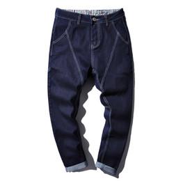 China Hip Hop Style Loose Harem Pants Blue Jeans Men's New Spring Autumn Long Denim Jeans Large Size Loose Size 44 cheap jeans large hip hop suppliers