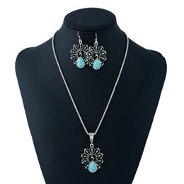 $enCountryForm.capitalKeyWord NZ - European and American folk style hollow peacock necklace earring set long retro pendant sweater necklace women nice accessories free ship