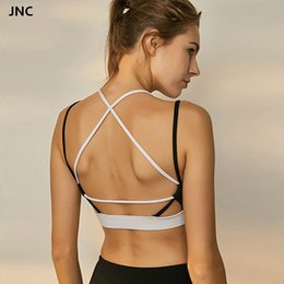 5a74ce5214 Women s strappy sports bra open back sexy gym bra workout padded yoga top  cross back gym crop top medium impact fitness
