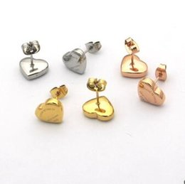 32892eb15f04 Precio de venta al por mayor de calidad superior T sello corazón pendientes  18 K chapado en oro 3 colores 316L pendientes de las mujeres de acero  inoxidable ...