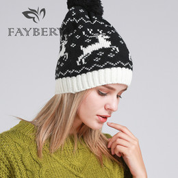 72abe7edb4c Fashion Brand Knitted Beanies Women Cap High Quality Winter Keep Warm Pom  Poms Hats for Women Faux Fur Ball Ski Deer Printed