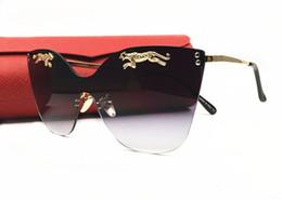 664f613d35 Francia marca Design Leopard On Lens Cat Eye gafas de sol sin montura para  mujer para hombre Hipster Leopard UV400 Lente Lentes Gafas con caja
