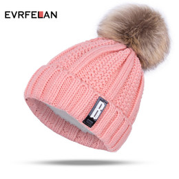 Beanies For Winter NZ - 2018 New Pom Poms Winter Hat for Women Fashion Solid Warm Hats Knitted Beanies Cap Brand Thick Female Cap Wholesale Y18110503