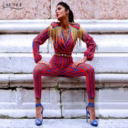 398b0c6a9c wholesale 2018 New Runway Fringe Jumpsuits Bodysuit Women Celebrity Party  Jumpsuit Long Sleeve Red Blue Striped Tassel Jumpsuit