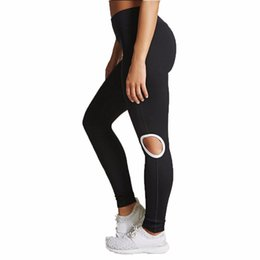 Chinese  Women's Knee Hollow Yoga Pants High Quality Sexy Solid Color Workout Leggings Fitness Sports Gym Running Yoga Athletic Pants manufacturers