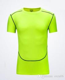 T-shirt aderente tinta unita traspirante traspirante compressione fitness abbigliamento sportivo maschile a maniche corte in Offerta