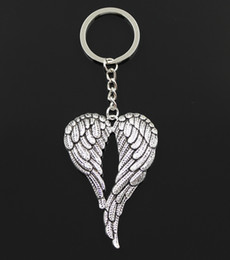$enCountryForm.capitalKeyWord Canada - free shipping 20pcs lot Key Ring Keychain Jewelry Silver Plated Angel Wings Charms