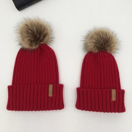 7675ba5f138 Mom And Kids Knitted Pom Pom Hats For Women Children 2018 Winter Wool Warm  Faux Fur Pompom Cap Boys Girls Skullies Beanie Hats