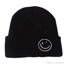 Chinese  Kids hat Cartoon smiley baby cap 2019 new child autumn and winter knitwear fashion curly edge earmuffs warm hat wholesale manufacturers
