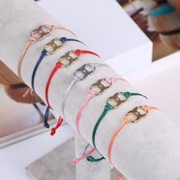 Großhandel 2018 Top-Qualität Messing Material Liebe Punk viele Farben Neue Umarmung Ambition Silk Gemini Armband in 1,8 * 1,1 cm Anhänger mit Logo Frauen Juwel