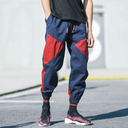 Man Trunks Tempo libero Pantaloni Harens Pantaloni alla moda Hip-hop Pantalone Hiphop Pantaloni a matita a colori a collisione di movimento Senza cintura Legatura blu Patchwork in Offerta