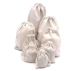 $enCountryForm.capitalKeyWord UK - Wholesale 50pcs lot Natural Color Cotton 7x9cm Small Cloth Packing Bags Guaranteed100% Cotton Linen Gift Bags Customize logo