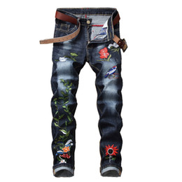 China 2018 new hip hop Famous Flower Embroidered Jeans Straight Slim Fit Mens Printed Biker Denim Trousers jeans pants cheap yellow pants flowers suppliers