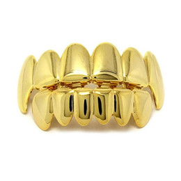 China New Hip Hop Gold Teeth Grillz Top & Bottom Dental Grills Mouth Punk Teeth Caps Cosplay Party Tooth Rapper Jewelry Set cheap dental gold suppliers