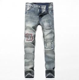 666682f29106c Viejos Agujeros Jeans Online