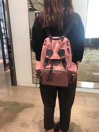 Backpack stitching online shopping - Men and women carry backpacks Waterproof fabric stitched together with leather shoulder bags A handle is provided at the top for lifting