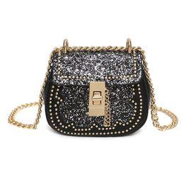 Chinese  J&Q hot sale Female mini bag kid girls fashion messenger travel bag,sparkle baby candy bag black lock children manufacturers