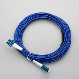 Cable de conexión de fibra óptica Armored Single mode SM LC 9/125 Cable de conexión de fibra óptica de 20 metros fábrica Personalizar longitud de conector LC LC en venta
